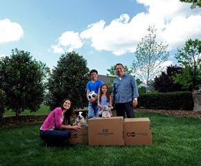 family with moving boxes